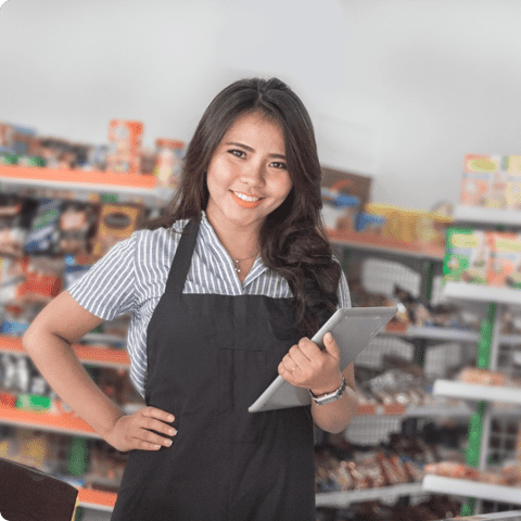 female convenience store employee standing inside store